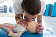 Paramedic practising resuscitation mouth to mouth on dummy Stock Photography