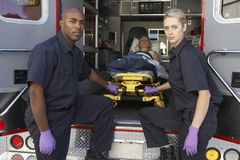 Paramedic preparing to unload patient Stock Photos