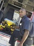 Paramedic removing gurney from ambulance Stock Images