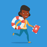 Paramedic running with first aid box. African-american paramedic running with first aid box. Young paramedic running to patients. Emergency doctor running with Stock Photo