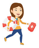 Paramedic running with first aid box. Caucasian paramedic running to patients. Paramedic running with first aid box. Emergency doctor running with first aid box Royalty Free Stock Photography