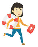 Paramedic running with first aid box. Young asian paramedic running to patients. Paramedic running with first aid box. Emergency doctor running with first aid Stock Photography