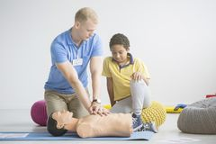 Paramedic showing first aid exercises stock photos