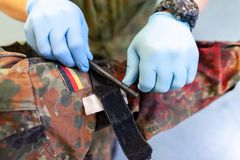 Paramedic soldier medicates a make up fracture. Soldier medicates a make up fracture stock photo