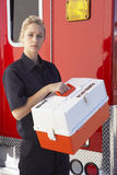 Paramedic standing by ambulance with medical kit Stock Image