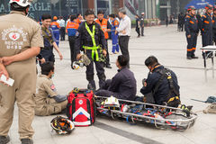 paramedic and stretcher gurney in mock disaster drill Royalty Free Stock Image