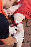 Paramedic taking a blood sample Royalty Free Stock Images