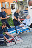 Paramedic team assisting injured man on stretcher Stock Images