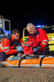 Paramedic team giving firstaid to injured woman Royalty Free Stock Photography