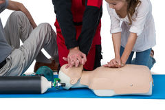 Paramedic training cardiopulmonary resuscitation to girl Stock Photo