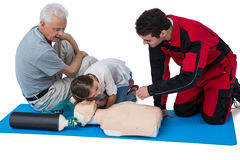 Paramedic training cardiopulmonary resuscitation to senior man and girl Royalty Free Stock Images