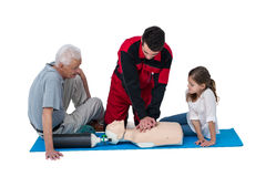 Paramedic training cardiopulmonary resuscitation to senior man and girl Stock Images