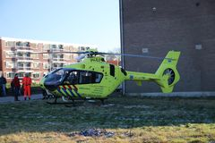 Paramedic trauma helicopter PH-ELP or Lifeliner 2 leaving scene of incident in Waddinxveen the Netherlands. Paramedic trauma helicopter PH-ELP or Lifeliner 2 royalty free stock images
