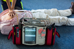 Paramedic using an external defibrillator during cardiopulmonary resuscitation Stock Photo