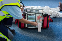 Paramedic using an external defibrillator during cardiopulmonary resuscitation Royalty Free Stock Photography