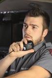 A paramedic at the wheel of his ambulance Royalty Free Stock Image