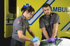Paramedic who make a cardio-pulmonary Stock Photography