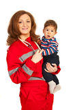 Paramedic woman holding baby Royalty Free Stock Images