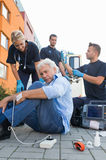 Paramedical team giving firstaid to injured man Royalty Free Stock Image