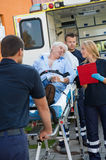 Paramedical team helping injured man on stretcher Stock Images