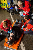Paramedical team helping injured motorcycle driver royalty free stock photo