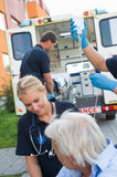 Paramedical team helping injured patient on street Royalty Free Stock Photography