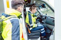 Paramedics in ambulance Royalty Free Stock Images