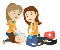 Paramedics doing cardiopulmonary resuscitation. Stock Photography