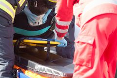 Paramedics and firefighters in urgent rescue operation after accident royalty free stock photos