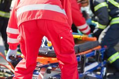Paramedics and firefighters in urgent rescue operation after road traffic accident. Paramedics and firefighters in urgent rescue operation after a car crash stock photos