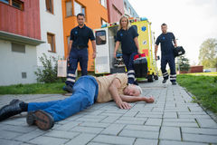 Paramedics giving help to injured senior man Stock Photo