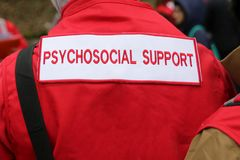 Paramedics mountain rescue service Psychosocial Support. Paramedics from mountain rescue service provide first aid during a training for saving a person in royalty free stock images