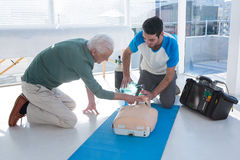 Paramedics practicing cardiopulmonary resuscitation on mannequin Royalty Free Stock Photo