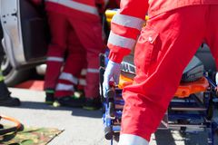 Paramedics in a rescue operation after road traffic accident. Paramedics in a rescue operation after a car crash royalty free stock images
