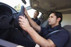 Paramedics Responding To Emergency In Ambulance Royalty Free Stock Photography