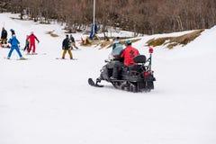 Paramedics riding snowmobile, Miyazaki, Japan. February 4, 2017. A paramedic rides on a snowmobile to a snowboarding tourist injured in an accident. Gokase ski Royalty Free Stock Image