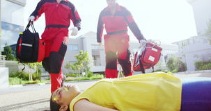 Paramedics running towards injured girl