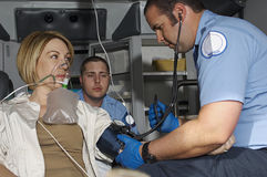 Paramedics Taking Care Of Victim In Ambulance Royalty Free Stock Photography