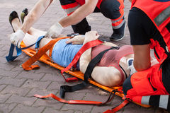 Paramedics taking woman to the hospital Stock Images