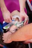 Paramedics using oxygen mask Royalty Free Stock Photography