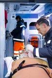Paramedics With Patient Stock Photo