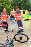 Paramedics with woman on stretcher ambulance aid. Bike accident paramedics with women on emergency stretcher ambulance aid stock image