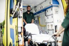 Paramedics at work with an ambulance royalty free stock photo
