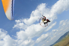 Paramotor on blue sky Stock Image