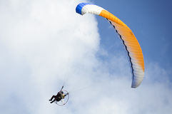 Paramotor on blue sky Stock Photos