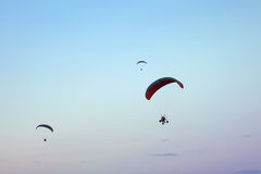 Paramotor in the blue sky Royalty Free Stock Photo