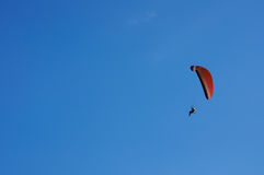Paramotor Extreme sport flying on blue sky Royalty Free Stock Photography