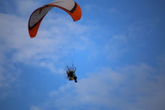 Paramotor flying in the sky Stock Photography