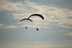 Paramotor flying in the sky Royalty Free Stock Image