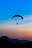 Paramotor flying in the sky Stock Photos